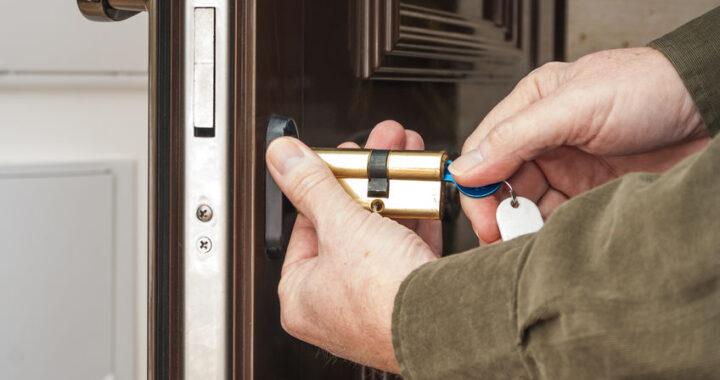 Locksmith replacing a cylinder lock